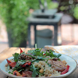 Walnuts are the perfect complement to this Thai inspired barbeque bowl that's a  mix of brown rice, roasted red peppers,  BBQ chicken, arugula, garbonzo beans and  drizzled with  a warm  sweet and sour sauce.