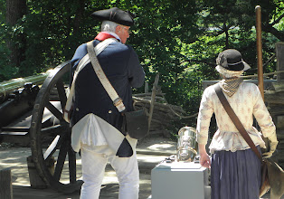 Photo: They are getting ready to fire the small cannon which is between them.