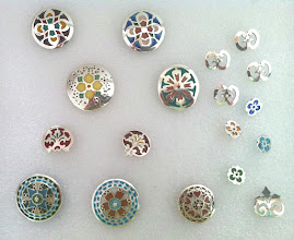 "Photo: Fine Silver and Fine Silver/Eamel Buttons (plique-a-jour technique)  Sizes from approximately 3/8"" to 1-1/8""  All are for sale and priced from $35. - $325. USD  All are handmade by Diane Echnoz Almeyda  (Please pardon the poor photograph.)  Please visit my website at www.plique-a-jour.com   You may contact me through the link on my contact page."