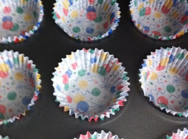 Line muffin tins with cupcake papers and preheat oven to 350.