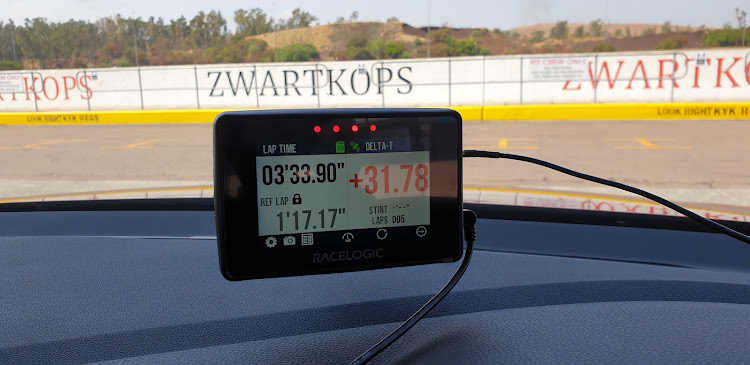 A Vbox mounted on the dash shows how your current lap compares with your quickest lap time. Picture: DENIS DROPPA