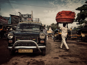 Photo: More typical street scenes from a slum in Mumbai, including the iconic Padmini Taxi and Auto Rickshaws in black and yellow. www.michiel-delange.com