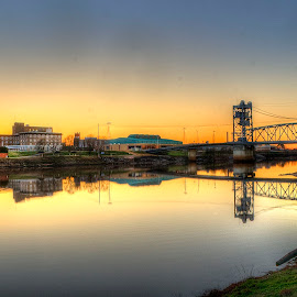 Quiet Evening by John Larson - City,  Street & Park  Skylines ( city, reflections, sunset, skyline, bridge, river )