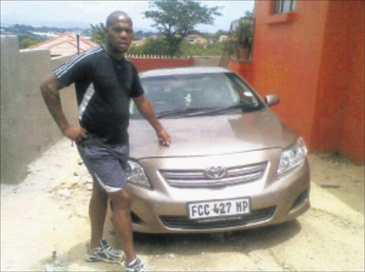 HAPPY CONSUMER: Jones Mashego and the car Motor Finance Corporation made the car dealer take back.