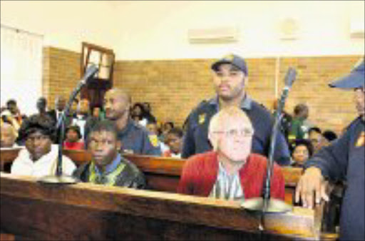 FREE AGAIN: Maria Mnisi, Phineas Johnson and Fanie Hyman, who ordered the couple to exhume their child on his farm, together in the dock before charges against the couple were dropped in the Koppies magistrate's court. Pic. Peter Mogaki. 22/04/08. © Sowetan.