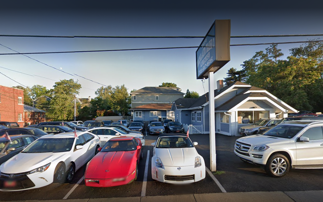 Photo of cars lined up in front of Virginia Auto Trader office