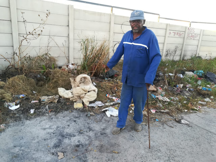 Buyisile Nomnganga points at the area where one of the two foetuses was found outside Greenpoint High School.