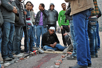 Photo: Protesters remained in Tahrir Square in disbelief at the amount of blood shed over the course of the attack.