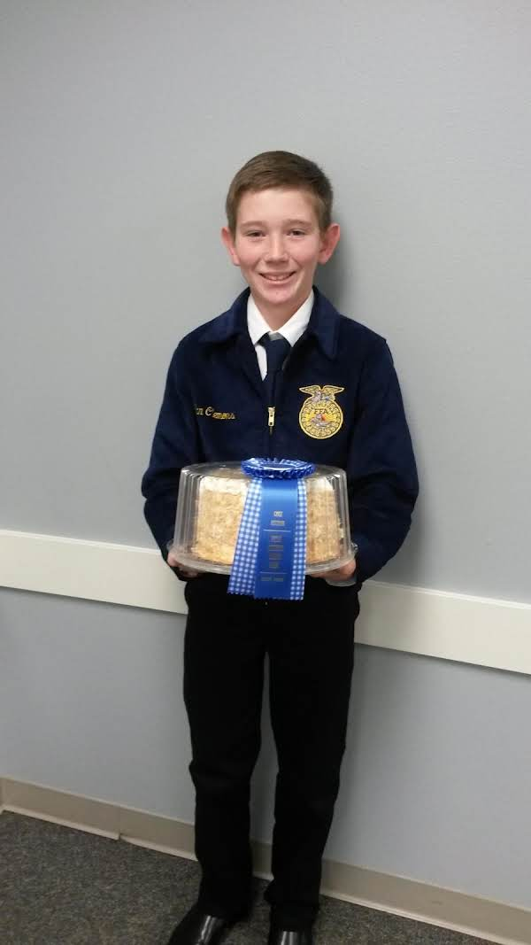 My Son With His Award Winning Coconut Cake!