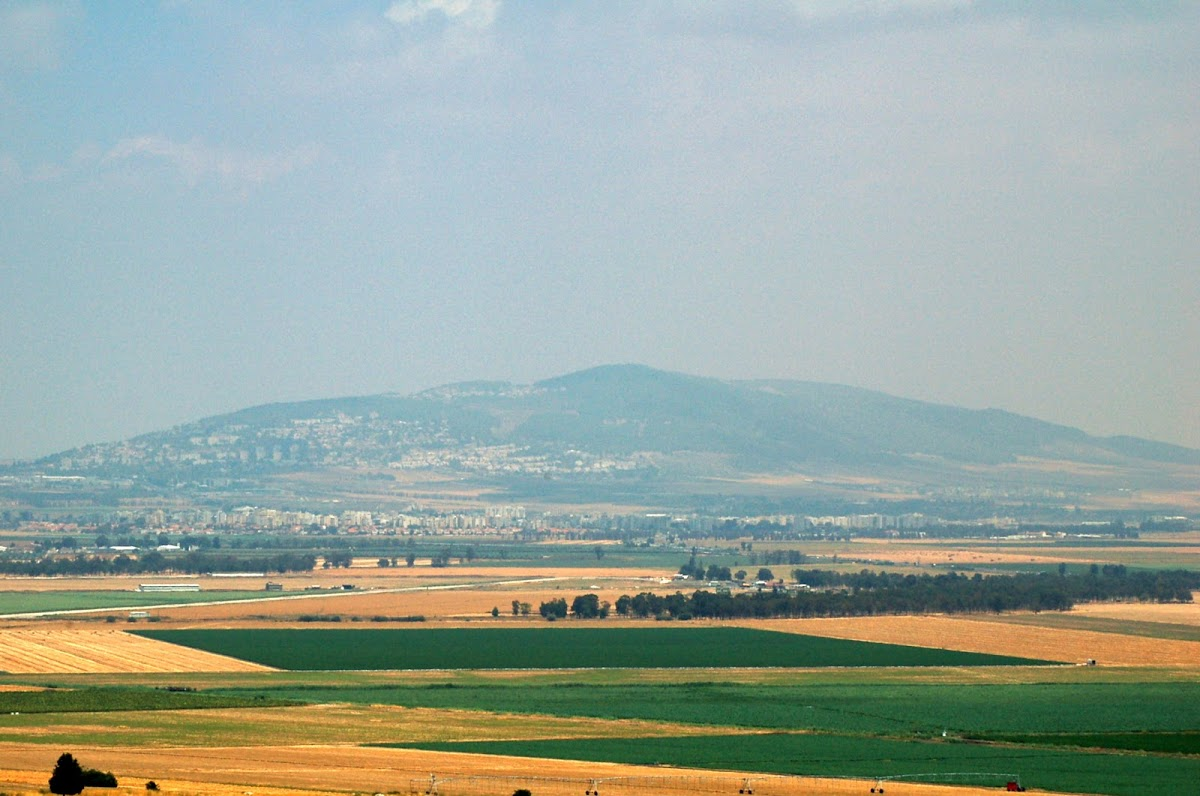Nazareth on hill across Valley of Jezreel from Tel Megiddo