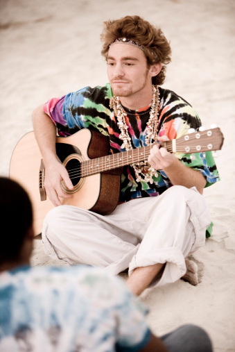 Young hippie playing a guitar.jpg