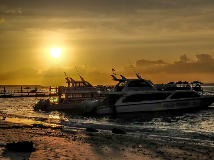 gorgeous sunset behind the ships on nusa penida island indonesia