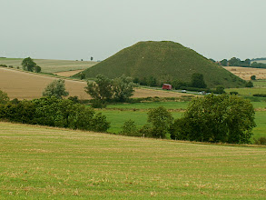 Photo: Silbury Hill burial mound on Salisbury Plain, about 5000 yrs old.  An English pyramid. I guess the volume is about 1/2 x 100 x 100 x 30 m = 1e5 m^3. Then mass = 3e8 kg.  Assume one person carries 30 kg per trip and can make 2 trips up-and-down per hour.  Then, 3e8/30/2 = 5e6 hrs.  A person work-year is 2000 hrs (40 hr/wk x 50 wks), so this represents about 2500 person years, just to carry the dirt up the hill.  If it was built for an individual, it probably took <25 yrs to create, because people didn't get very old back then.  100 people working solidly for 25 yrs could have done it.  Maybe double the number to account for digging up the dirt and bringing it to the site.  If you did this now, manually, 1 person yr would be about 100k$, so 2500 x 0.1M$ = 250M$, or double that for the people to bring the dirt in.  This is a half-billion dollar pile of dirt.  Very few people in the country could afford this, explaining why Silbury Hill is unique in scale.  It was a power display, amongst other things.