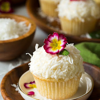 Coconut Cupcakes with Coconut Buttercream Frosting.