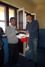 Photo: Michael handing over, to Dorje Sir of Chilaune, jerseys and shorts for the children!