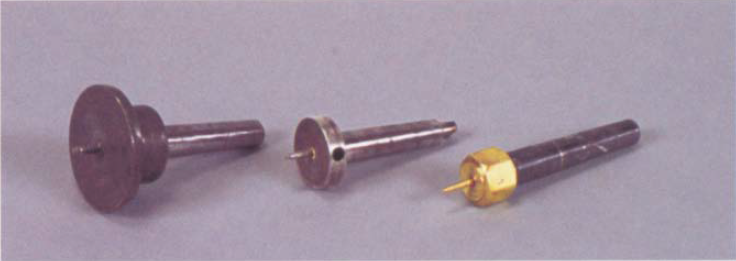 Traditionally. screw chucks were used for light work and were built on Morse-taper blanks.