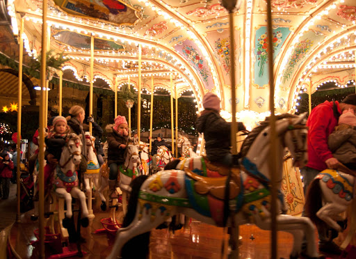 Children ride the carousel during the Christmas market in Trier, Germany.