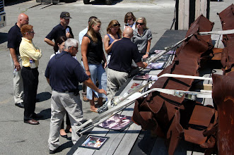 Photo: Staffers visit a piece of steel from the World Trade Center collapse, while reviewing photos of the MA-TF 1 deployment to that incident.