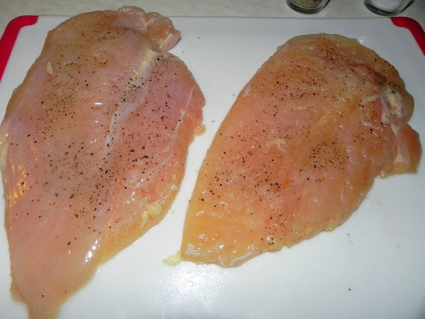 Take your sliced chicken halves or flattened out chicken and rinse off with water....