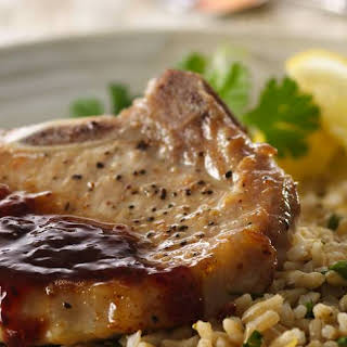 Pork Chops with Raspberry Chipotle Sauce and Herbed Rice.
