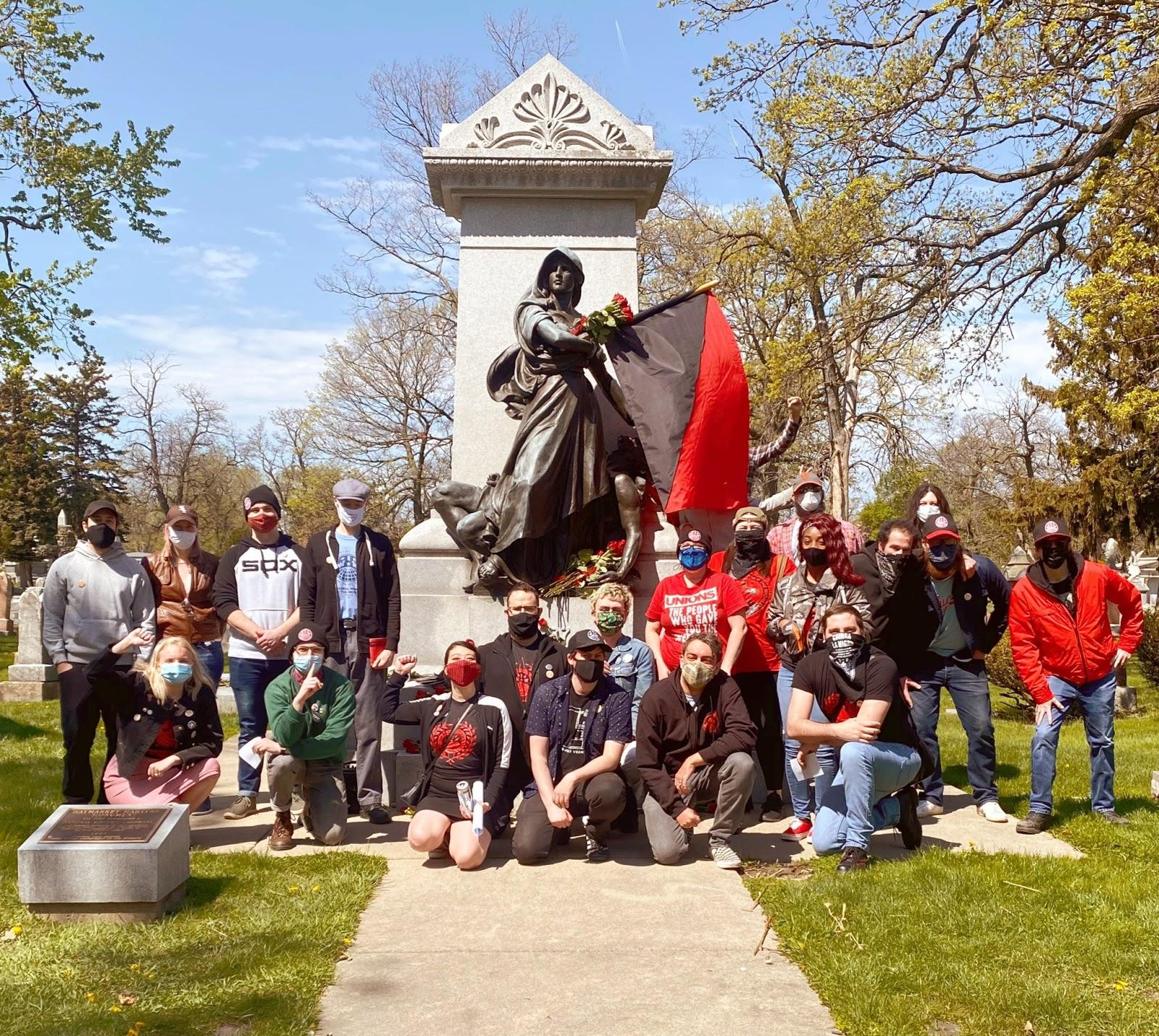 This photo shows some of the Greater Chicago IWW membership at the Haymarket Martyrs Monument