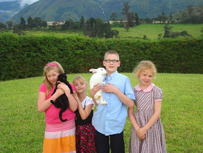 Photo: Our kids and their black and white pets. The black cat is called Charcoal (Coal for short) and the white rabbit is named Snowball.