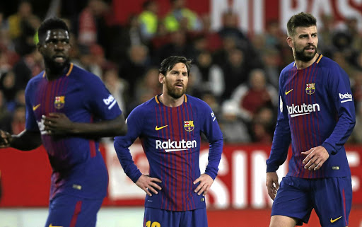 Barcelona superstars Samuel Umtiti, left, Lionel Messi, centre, and Gerard Pique are all likely to be given some game time against Sundowns at FNB Stadium in Wednesday's sold-out friendly. Picture: REUTERS