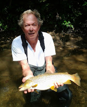 """Photo: It's great to have a true year-round trout fishery in our """"neighborhood"""". The Mad simply doesn't slow down much at all this time of year. Here's Michael Losinski on a guide trip with Lou yesterday. Lou is out again today....we'll see if he can duplicate or top?"""
