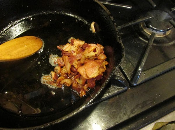 Cut bacon into small pieces and cook till nearly crisp. Saute onions in bacon...