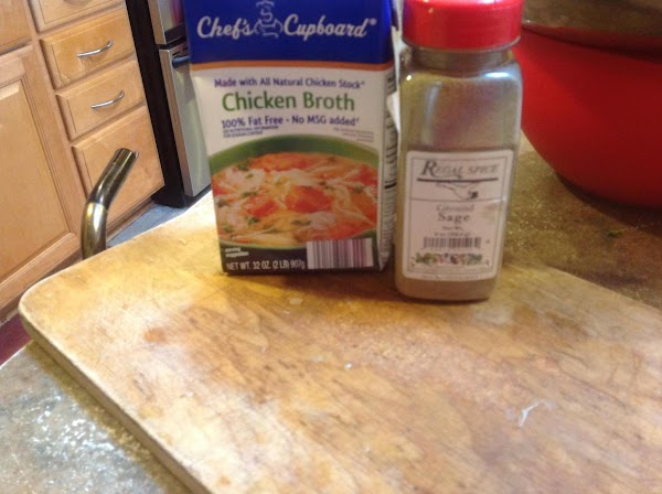 Add in the chicken broth and sage or poultry seasoning, & thyme and stir...