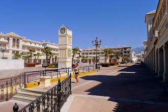 Photo: Newly built plaza with underground parking, un-let apartments and empty shops, behiond ayuntamiento