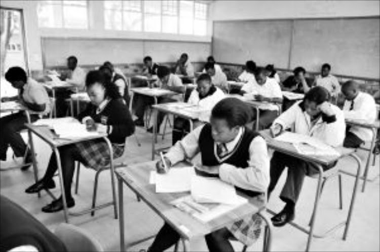 Matric pupils at Meadowlands Secondary School in Soweto write their English exam. File Picture: SOWETAN