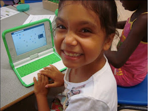 Photo: 5 year old girl making contact with a laptop of one of her friends.
