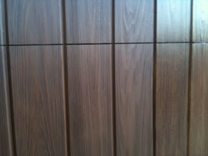 """Photo: Cedar Park Overhead Doors Demo Door with multiple finishes. This photo is a close up of the Factory """"Walnut"""" Color. Available for viewing at 2507 S Bell Blvd. Cedar Park TX 78613. 512-335-7441"""