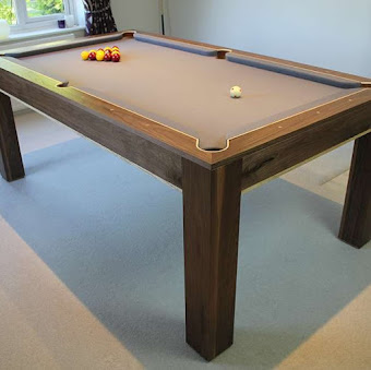 The refined pool table on a carpet with light brown felt