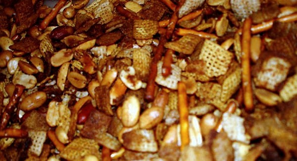 In a large glass bowl, combine cereals, crackers, pretzels and nuts. In a small...