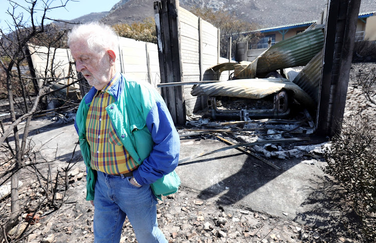 Dr Francois Greeff with the remains of his Rolls Royce and his house in Betty's Bay on Saturday January 12 2019.