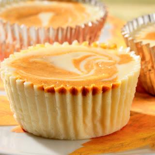 Individual Swirled Pumpkin Cheesecakes.