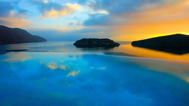 "Photo: The Blue Palace Resort & Spa in Crete, Greece offers spectacular sunset views over the Island of Spinalonga, the setting for ""The Island"", one of the most romantic novels. See more of the hotel here: http://bit.ly/Ke3sjq"