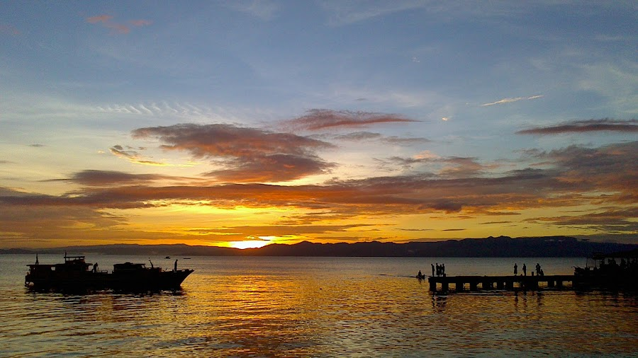 A beginning of the day: the fishing business by Panji Nursasongko - Instagram & Mobile Android ( dawn, pier, seaside, sunrise, boat, morning )