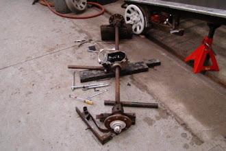 Photo: Rear axle disassembly. Aluminum frame and wheels removed.
