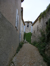 Photo: The village bell tower down a narrow lane.