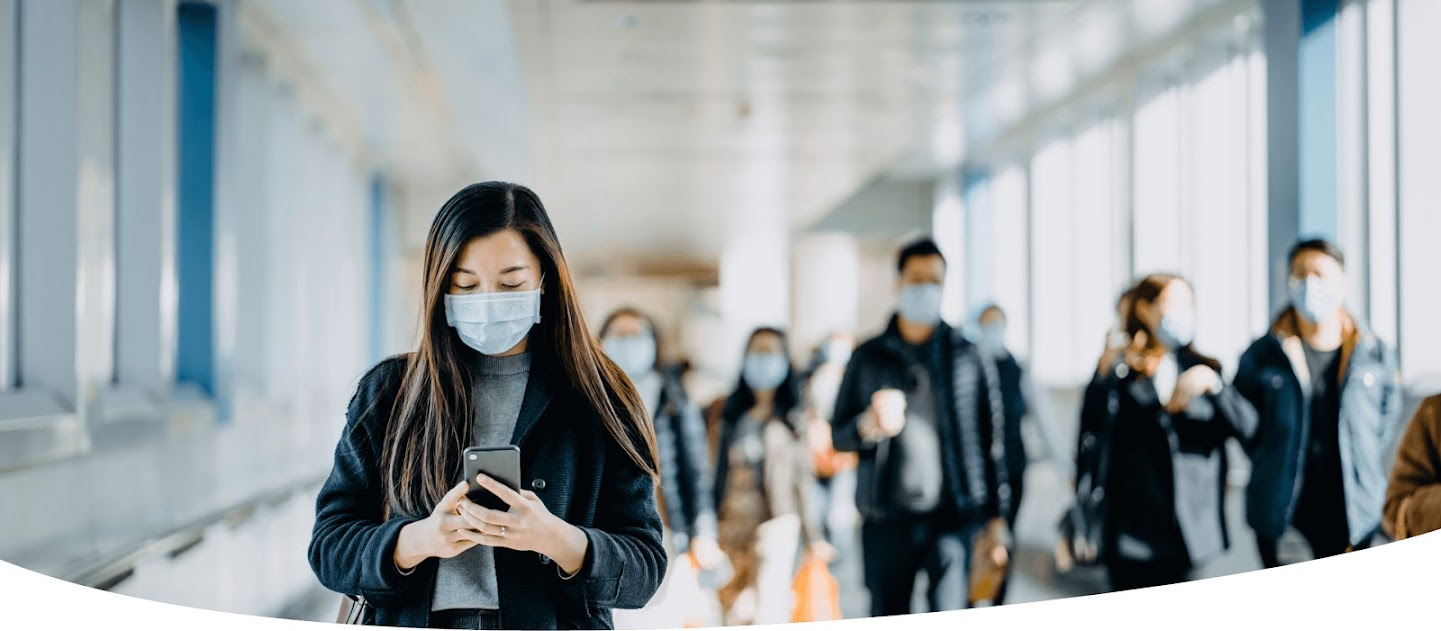 Group of people walking with masks on
