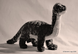 Photo: Dave the Dinosour.  150mm lens, f/8, 15sec pre-flashed ilford MGIV VC paper, yellow filter.  Bit of swing on the lens so his front foot is out of focus, but his head body and tail are reasonably sharp; I wondered if it would look a bit like motion blur on his leg and give the impression of walking.