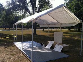 Photo: 10x20 white canopy, thicker poles  8 legs
