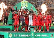 TS Galaxy celebrates by lifting their  trophy following their victory over  Kaizer Chiefs at their  Nedbank Cup final encounter yesterday at Moses Mabhida Stadium in Durban. TS has become the first lower division side to win the tournament.