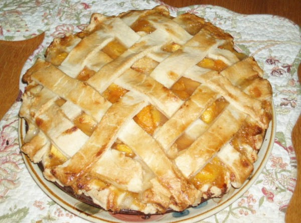 Combine sugar, flour, cinnamon, nutmeg and salt.  Add to peaches. Sprinkle with lemon...