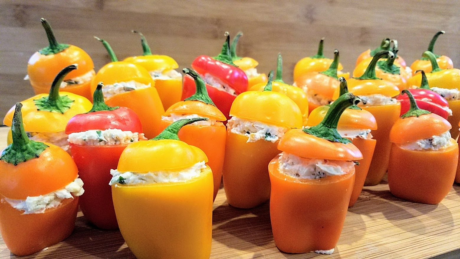 Recipe for Cheese Stuffed Mini Peppers, easy peasy and are adorable because of the way you can get multiple colors with the orange, yellow and red which are so cheerful, and then presentation wise the way they stand up in little rows or formations so bravely