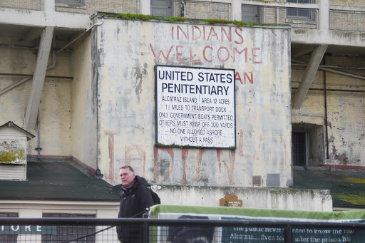 "sign.jpg - The sign that greets visitors to Alcatraz. The ""Indians welcome"" graffiti was added by a group that occupied the island in 1970."