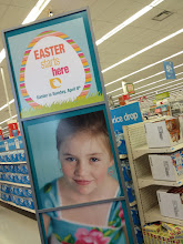 """Photo: Not too far from the ad circular stand, I saw this display that says """"Easter starts here"""". I like the look of this display, especially with the details at the top and the cute little girl in the bottom sections....it was eye catching to me."""